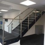 Steel staircase with stainless steel glass balustrade