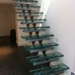 'Floating' staircase with glass treads