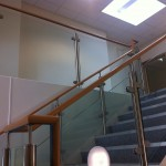 Stainless steel uprights with beech handrail and glass infill panels