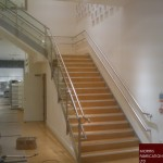 Steel stairs with wood covering and stainless steel balustrade