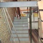 Steel stairs leading to mezzanine floor