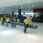 Steelwork being trollied through Airport Departure lounge