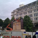 Using cherry picker to install cladding to TV screen