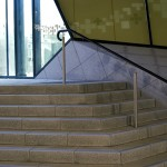 Stainless steel uprights with plastic handrail