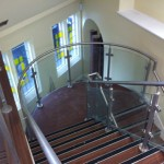 Steel staircase with stainless steel balustrade and curved landing