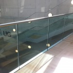 Frameless glass balustrade with stainless steel slotted tube top rail