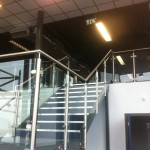 Stainless steel balustrade up stairs and across mezzanine at a gym in Birmingham.