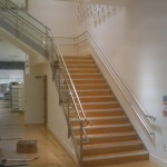 Steel staircase with stainless steel balustrade and wall rail