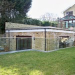 Frameless glass balustrade around garden terrace roof