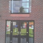 Prefixed juliette balcony fitted to first floor doors held with 6 nr stainless steel glass adaptors