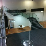 Stainless steel balustrade up stairs and across gallery