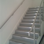 Stainless steel wall rail with balustrade prior to glass installation