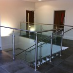 Stainless steel balustrade around landing and stairs
