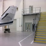 Galvanised steel staircase and landing at airport hangar