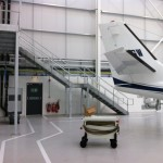 New galvanised steel staircase in airport hangar