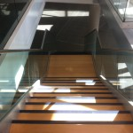 Frameless glass balustrade with stainless steel slotted tube top rail to stairs