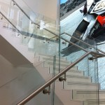 Steel staircase with terrazzo and frameless glass balustrade