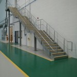 Galvanised steel staircase at airport hangar