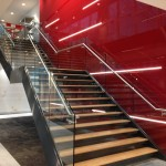 Feature staircase with frameless glass balustrade