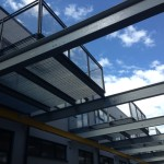Galvanised steel balcony with grille flooring