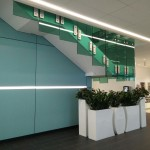 Green tinted frameless glass balustrade to staircase
