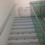 Precast concrete staircase (to be finished) with our frameless glass balustrade and stainless steel handrail