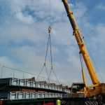 Walkway being lifted by crane