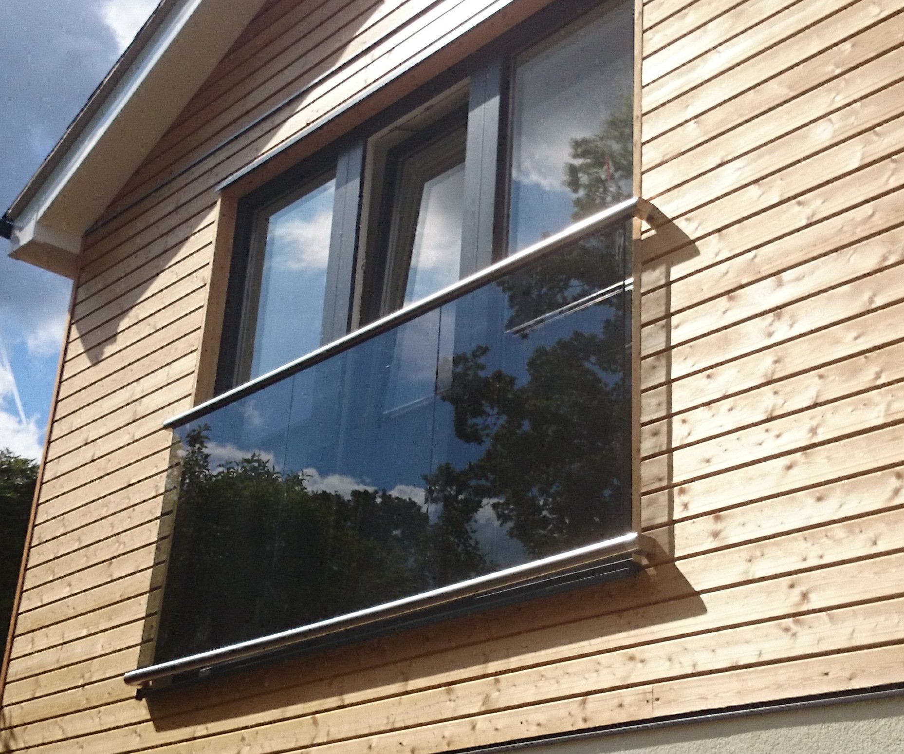 Glass juliette balcony morris fabrications ltd for Uses of balcony