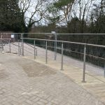 Stainless steel balustrade with curved horizontal running rails