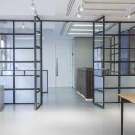 Fabricated mild steel metal frame with glass infill panels