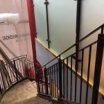 New steel staircase with vertical infill bar balustrade to stairs and obscured glass to gallery