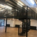 Mezzanine floor with spiral staircase, expanded metal balustrade, painted black