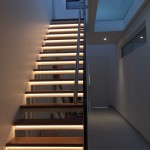 Residential staircase with frameless glass balustrade, LED backlit timber treads