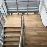 Internal steel staircase with stainless steel balustrade and timber treads