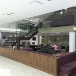 Airport lounge steel staircase with frameless glass balustrade