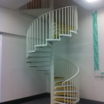 Mild steel spiral staircase powder coated white with GRP tread coverings for anti-slip