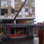 Crane removing steelwork from bridge