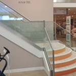 Frameless glass balustrade to steel staircase