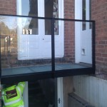 Powder coated bridge with glass infill panels and sandblasted glass floor