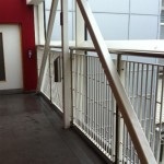 Powder coated infill balustrade with stainless steel uprights and top rail