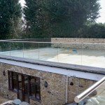 Frameless glass balustrade on terrace roof