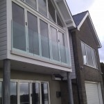 Frameless glass balustrade - side fixed aluminium U-channel