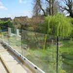 Frameless glass terrace balustrade during installation