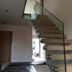Frameless glass balustrade supporting floating staircase