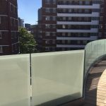 Curved frameless glass balustrade with 10% etch screen print glass and curved base U-channel