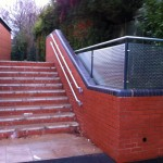 Not cold to touch handrail up stairs and perforated infill panels