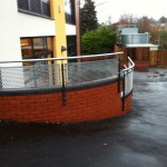 Not cold to touch balustrade with curved perforated infill panels