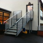 Galvanised steel staircase with aluminium perforated panel infills and not cold to touch handrail