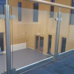 Stainless steel balustrade with timber top rail and glass infill panels