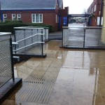 Powder coated uprights with plascoat top rail and aluminium perforated infill panels